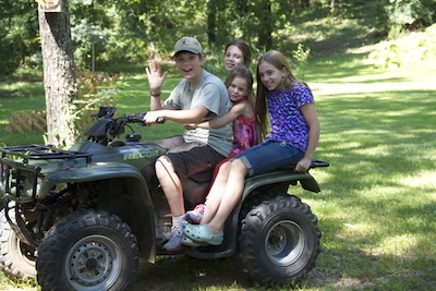 Kids having a blast at my Dad's on the Four-Wheeler