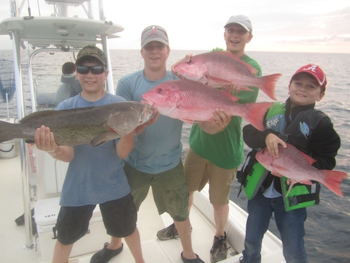 Stacy Harris' Boys: Howlett, Hampton, Hunter, and friend Zane holding up their catch!