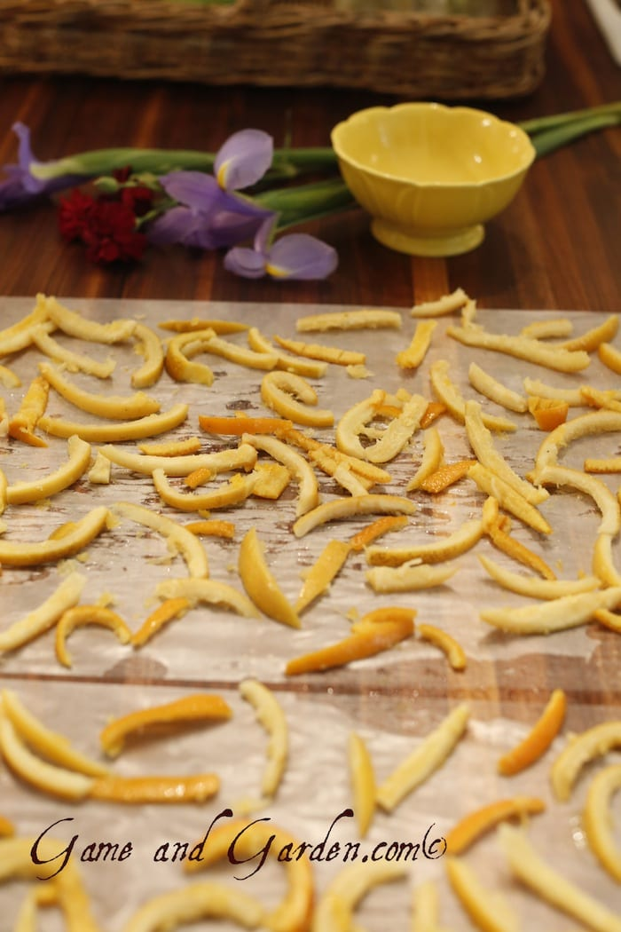 Allow the orange peels to dry for about 12 hours. They will not be completely dry when you coat them with sugar.