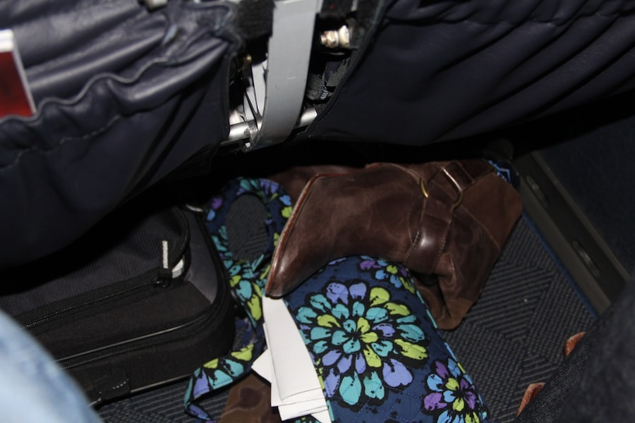 No, I didn't leave it this messy. This is when we were told we had to get off the plane so I took a quick picture while trying to get my other shoe back on!