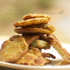 "Fried Green Tomatoes Ingredients 4 large firm green tomatoes 1 cup all-purpose flour 1 teaspoon salt, more for sprinkling 1/2 teaspoon pepper 2 eggs 1 Tablespoon water 1 cup bread crumbs 1 cup Olive Oil for frying 4 Tablespoons butter Slice the tomatoes 1/4 inch thick. On a large plate, mix flour, salt, and pepper. On a second plate beat eggs and water together. Place bread crumbs on a third plate. Coat tomato slices into seasoned flour, then egg mixture, then bread crumbs. In a hot sauté pan, mix butter and oil. When sizzling, place coated slices in pan for about 2 to 3 minutes per side or until tomatoes are tender. Cook in batches and add more oil if needed. Transfer to a platter, sprinkle with extra salt and serve warm. For a healthier version of this recipe, check out my Healthier Crunchier ""Baked"" Fried Green Tomato recipe."