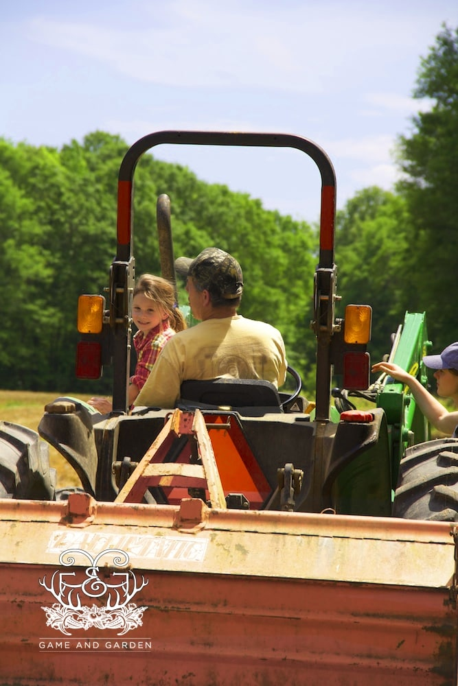 . I can barely get my baby (she is really growing up) off the tractor with her daddy, but I know her daddy LOVES IT!! Just look at them.