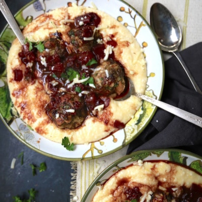 Meatballs with Wine Sauce over Polenta is one fantastic comfort food! They are amazing and simple to make!! gameandgarden.com