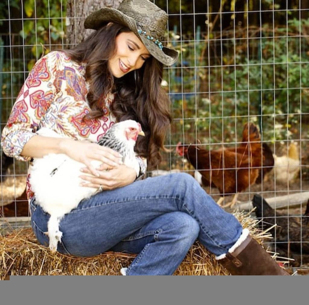 Stacy Lyn caressing a hen