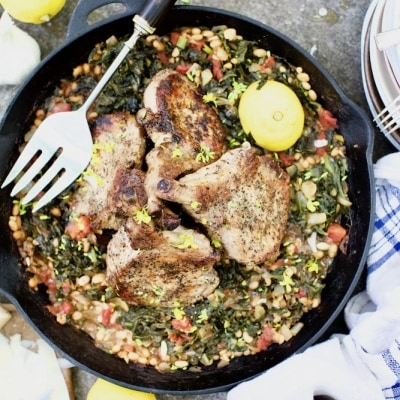 Pork chops cooked in cast iron skillet with wild plants