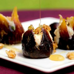 Figs baked and stuffed with honey mascarpone cheese filling drizzled with honey