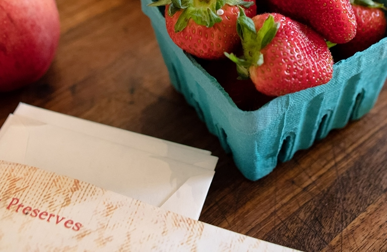 Pack of strawberries and other items on the table