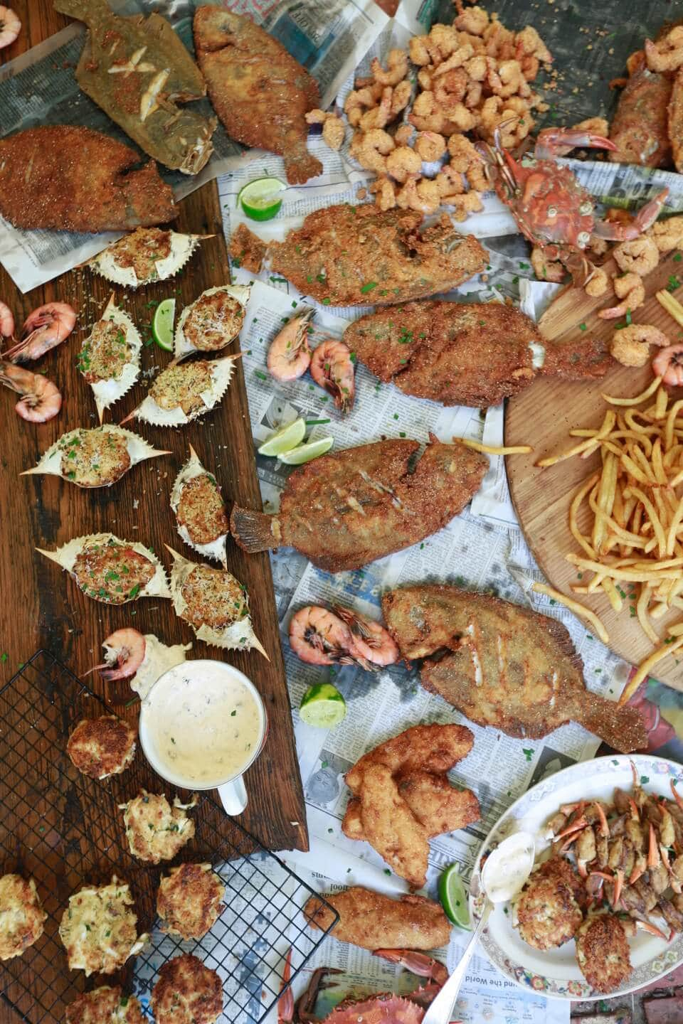Assortment of fried seafood, fish fry after catching shrimp crab and fish at the beach