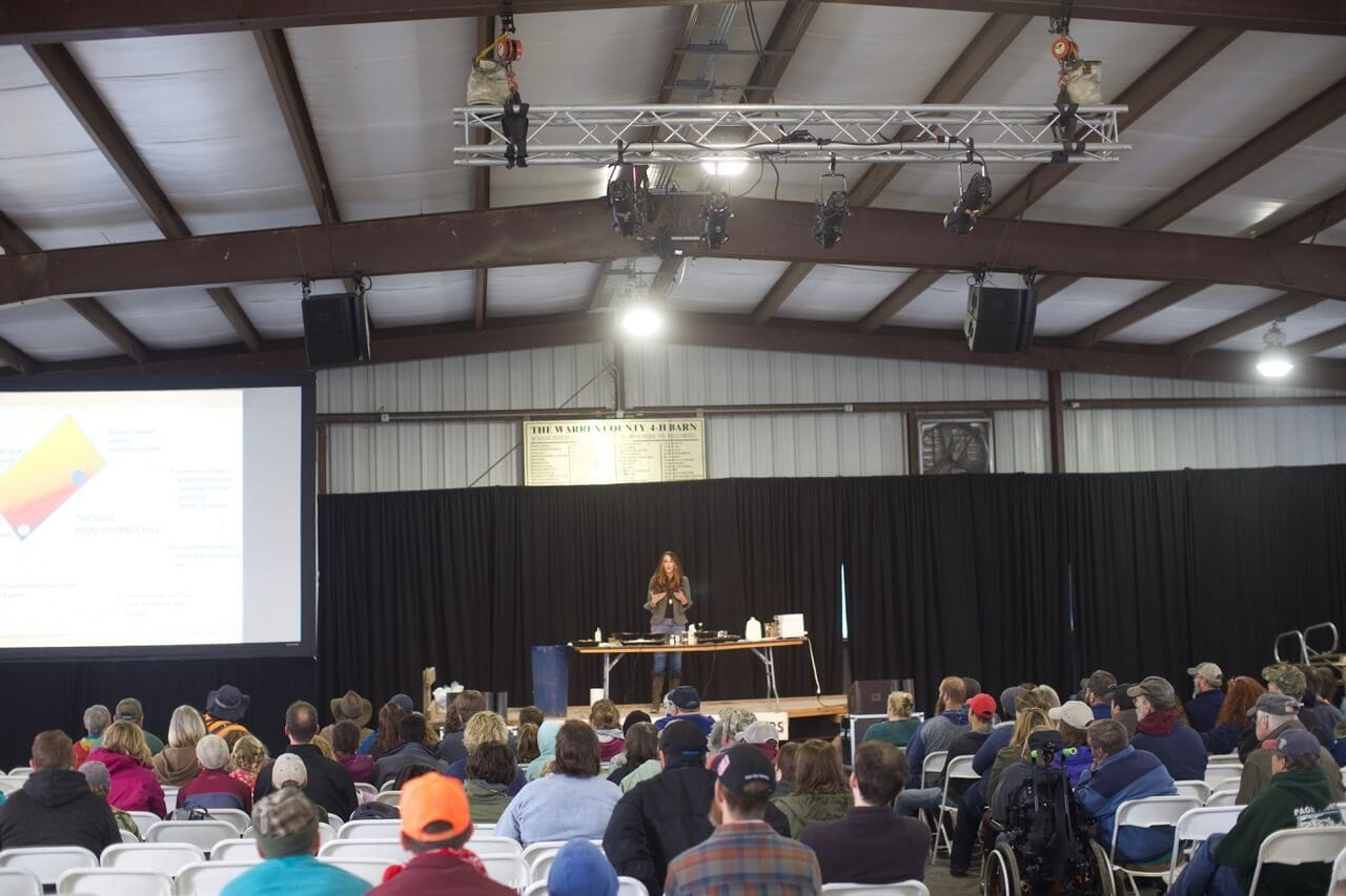 Stacy Lyn Harris speaking at the Homesteader's of America Conference in the Lehman's Barn