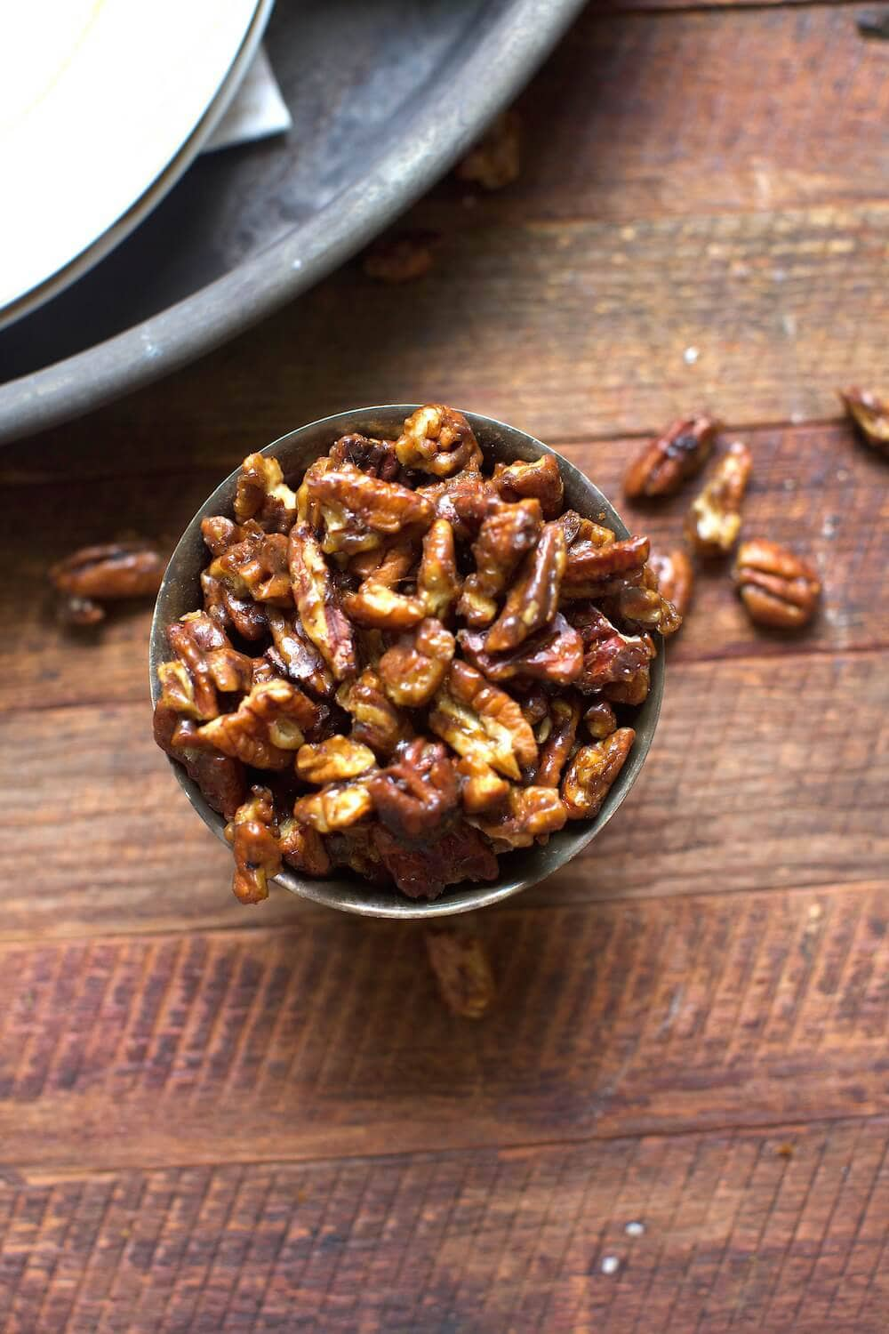 candied pecans served in a small cup