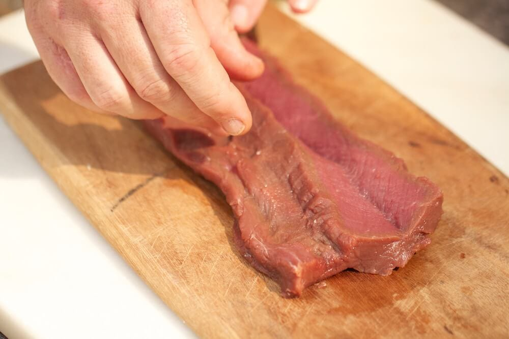 Picture of venison tenderloin, demonstrating the butterfly technique to stuff venison loins, photo by Stacy Lyn Harris