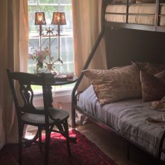 A picture of home decor and artwork in Stacy Lyn Harris's restful bedroom, from her blog on How to Create a Restful Bedroom