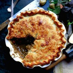 Southern squirrel pot pie with a slice removed, recipe by Stacy Lyn Harris from her Harvest Cookbook