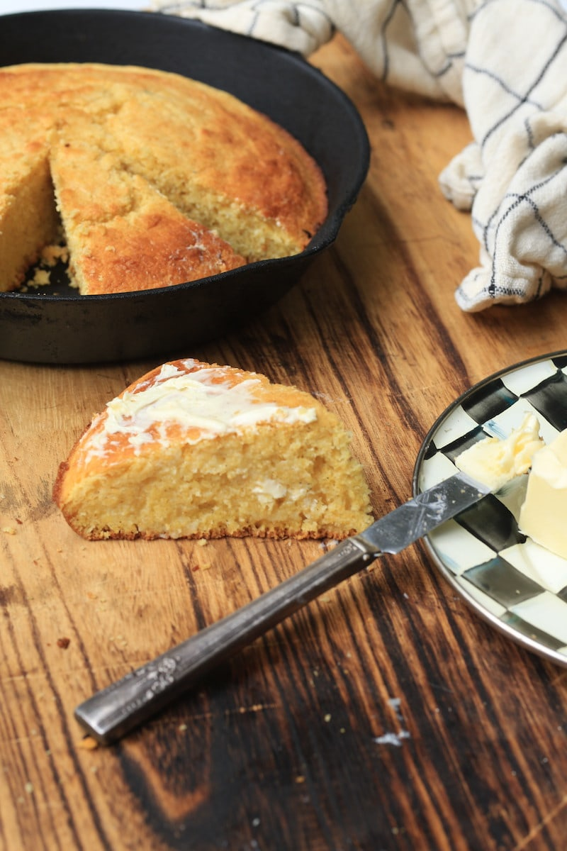Sweet Cornbread with melted butter on wood
