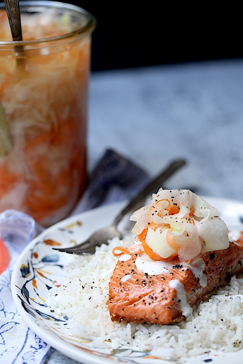 Salmon on A Bed of Rice with Pickled Daikon and Carrots on top