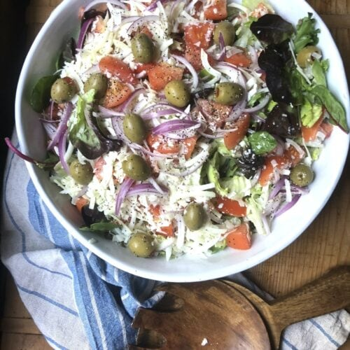 Italian salad recipe includes croutons and Parmesan tossed with fresh vegetables.