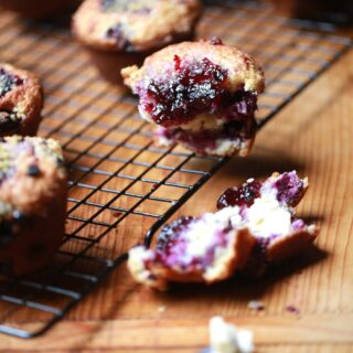 baked mixed berry muffins on cooling rack