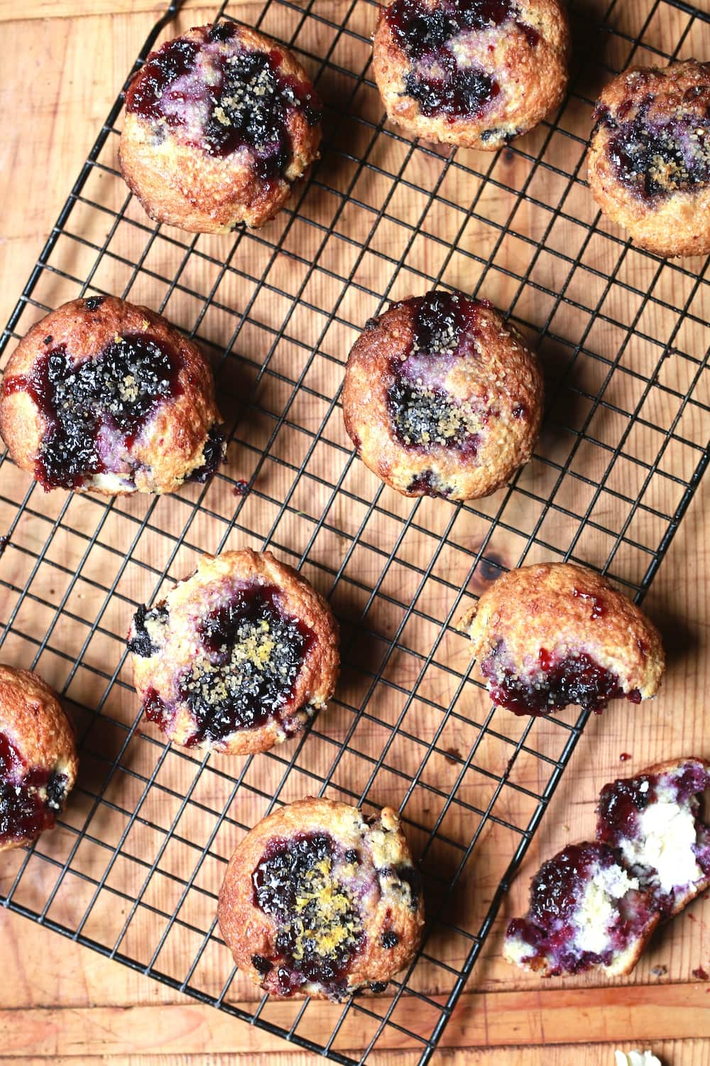 overhead view of berry muffins baked with sugar crumb topping