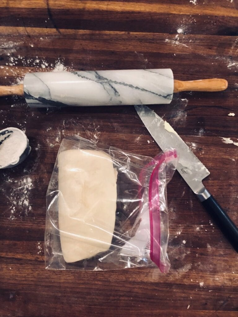 Fold dough on top of itself like a letter and place in a zip-top bag or wrap in plastic wrap and refrigerate for at least an hour.