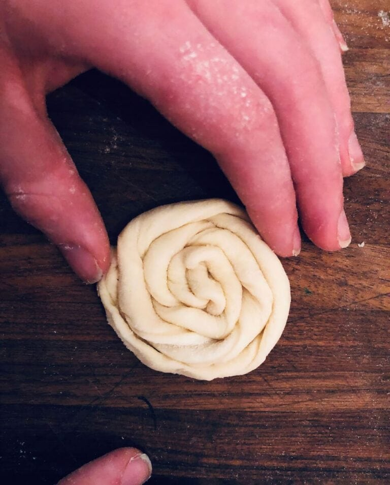Roll one end of the spiraled dough continuously to reach the other end to make a pretty spiraled pastry.