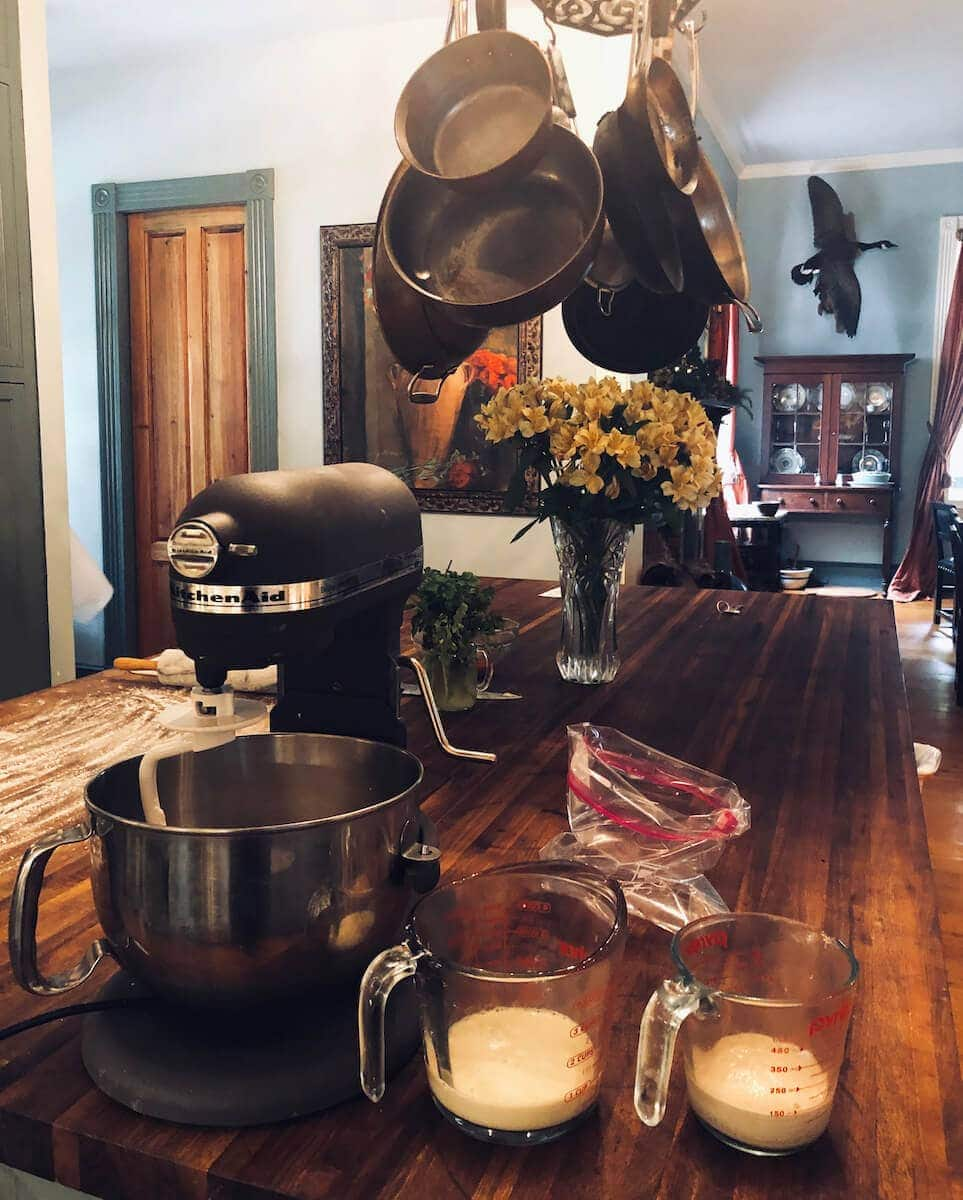 Add dry ingredients to the mixer, prepare the yeast mixture and milk, and allow the yeast to start working.